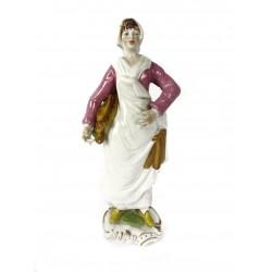 Figura de porcelana. Panadera.